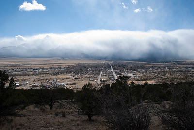 A spring storm flows over the Collegiate Peaks mountain range in central Colorado, bearing down on the town of Buena Vista.