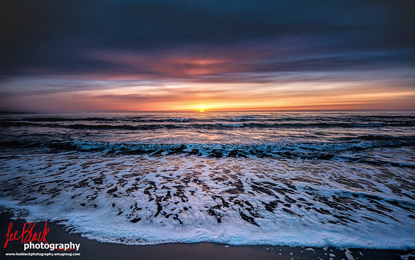 Sun eventually popping above the Horizon on the North Sea, at Easthaven, Scotland...