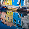 Reflections of colorful houses in canal, Island of Burano, Italy