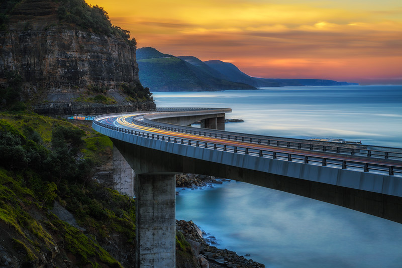 Sunset over the Sea cliff bridge along Australian Pacific ocean