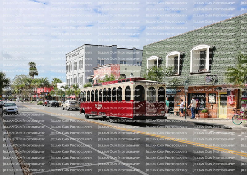 A trolley stops to pick up passengers on Donnelly Street, a popular tourist shopping destination in the heart of downtown Mount Dora.