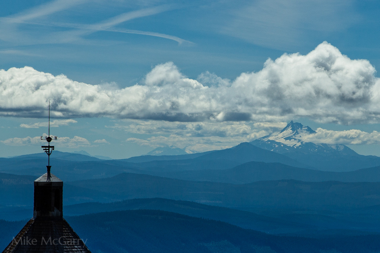 With the Timberline lodge weather vane in the foreground Mt. Jefferson is seen from the slopes of Mt. Hood forty miles to the south.