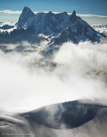 Climbers amidst the clearing storm....Mount Blanc Massif, Chamonix France