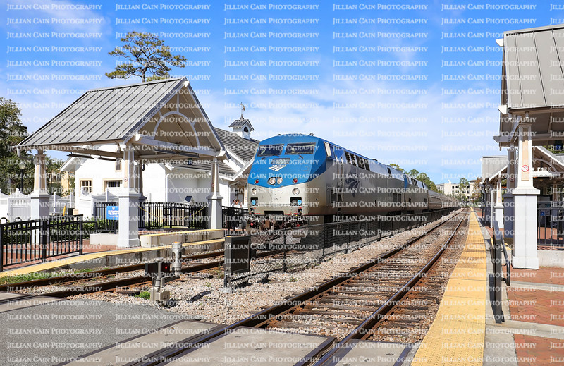 WINTER PARK, FLORIDA, USA: Amtrak train arrives at the Winter Park Station.  The station is serviced by SunRail, the commuter rail system of Greater Orlando, as seen on  January 26, 2020.