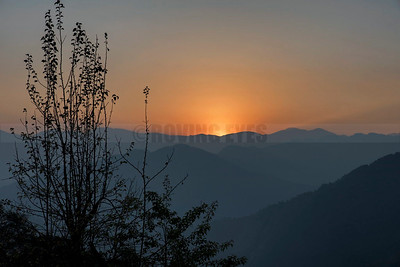 A14:The day ends in Borong,South Sikkim,as the sun touches the opposite peak on its way down.