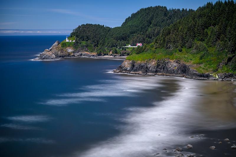 Long exposure of Cape Cove and the Heceta Head Lighthouse in the Cape Perpetua area of the Oregon Coast near Yachats, Oregon