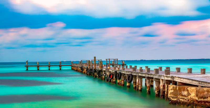 Wooden pier on clear turquoise water