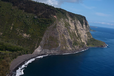 Waipio Valley and black sand beach, Big Island.  Only true 4x4 vehicles are allowed on the steep road to the beach.