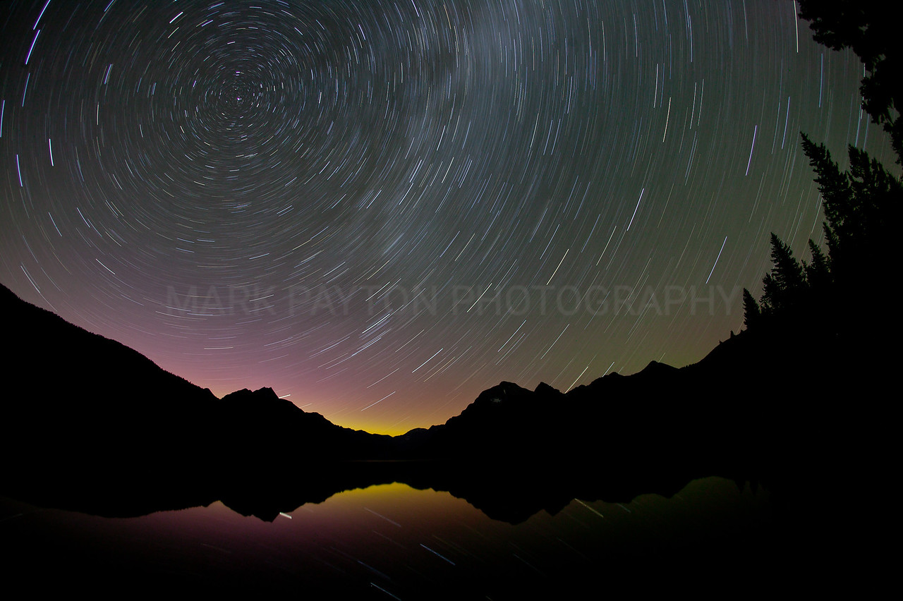 Star-Trails over Bowman Lake<br /> <br /> Star-Trails over Bowman lake in Glacier national park, MT July 2011<br /> <br /> Canon 1Ds MK I<br /> Canon EF 15mm f/2.8 fisheye <br /> <br /> Please Note: Watermark will not appear in printed image