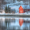 Red Fishing Hut near Tromso, Norway in the Early Morning Light