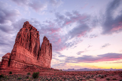 Sunrise lights up the grand beauty in Arches National Park.