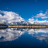 Mountains and clouds reflecting on Jackson Lake, Grand Teton National Park, Wyoming