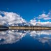Mountains and clouds reflecting on Jackson Lake, Grand Teton National Park, Wyoming
