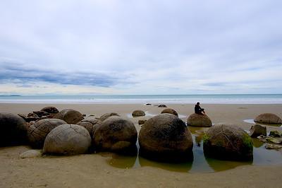 Figure on Moeraki Boulders- Koekohe Beach, New Zealand