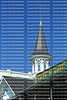 Close up of the Churchill Downs steeple and sign. against a clear blue sky