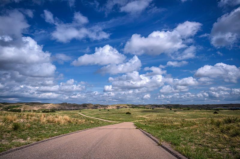 Clouds above a road through the  Nebraska Sandhills south of Valentine, Nebraska