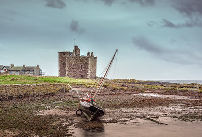 Portencross castle and a boat at Low tide