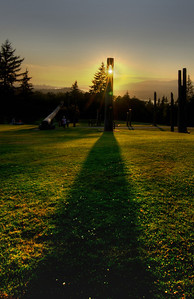 Light shining through a Japanese totem in Burnaby Mountain Park.