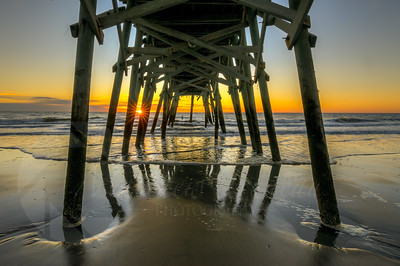 Beaten down, under surfside beach pier