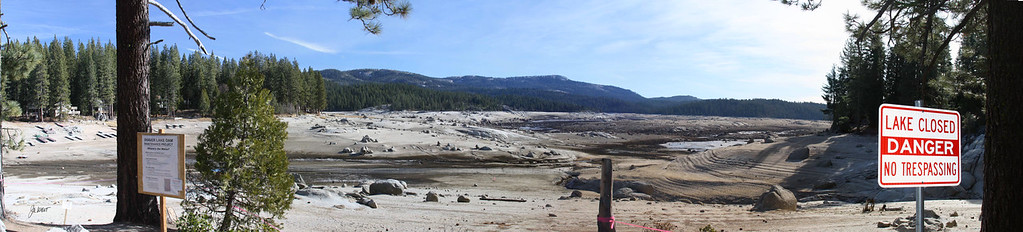 Shaver Lake, Ca.  Shaver was drained in 2011 so that the Dam could be relined.  The lake will be reflooded in 2012. The old dam and sawmill valve house are located at the bottom of the lake and are currently visible with a telephoto lens.  This view is from the parking area off of Highway 168.