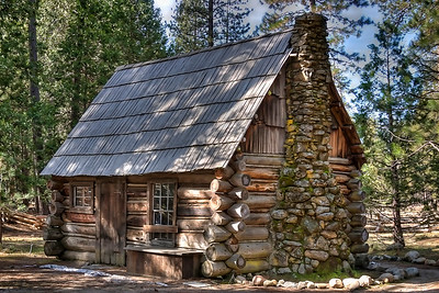 Mountaineer or Anderson Cabin.  George Anderson, a miner and blacksmith, worked as a guide in late 1800's, and escorted visitors in Yosemite.  In 1875, he was the first person to climb Half Dome.  He spent his winters in this cabin at Big Meadow (now called Foresta), and his summers in Yosemite Valley. The cabin was moved to the History Center in the 1950's or 60's.