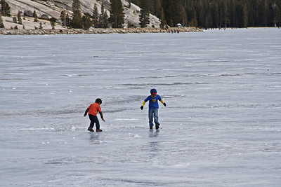 Playing ice ball on Lake Tenaya.  Skaters and people playing in the background are all on the lake.