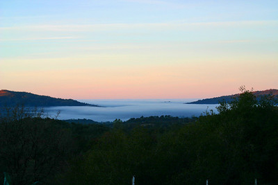 Sunrise facing west with fog over Cathey's Valley.