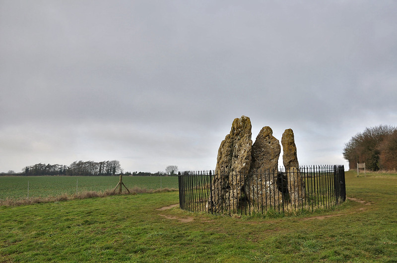 The Whispering Knights, the stone circle (aka the Kings Men) is at the very left of the coppice of trees on the left of the picture.