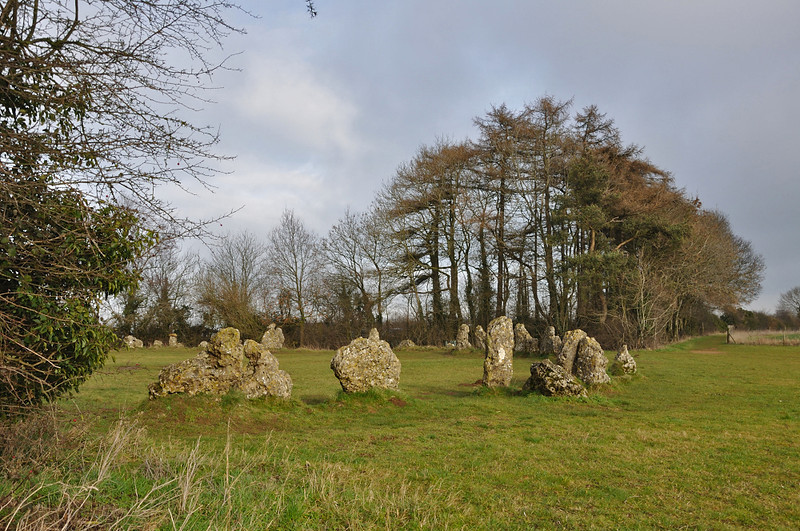 The Kings Men, the King Stone stands the other side of the trees on the left across the road, the path in front of the trees leads to the Whispering Knights