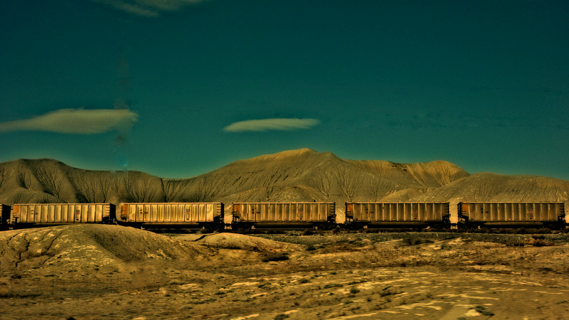 Train traveling through Utah against the desert. Colorized in Nik Software.