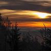 Solnedgang over Oslo med et teppe av frostrøyk liggende over byen, bildet tatt fra Røverkollen en sein desember dag, temperaturen lå på ca -20 kalde....