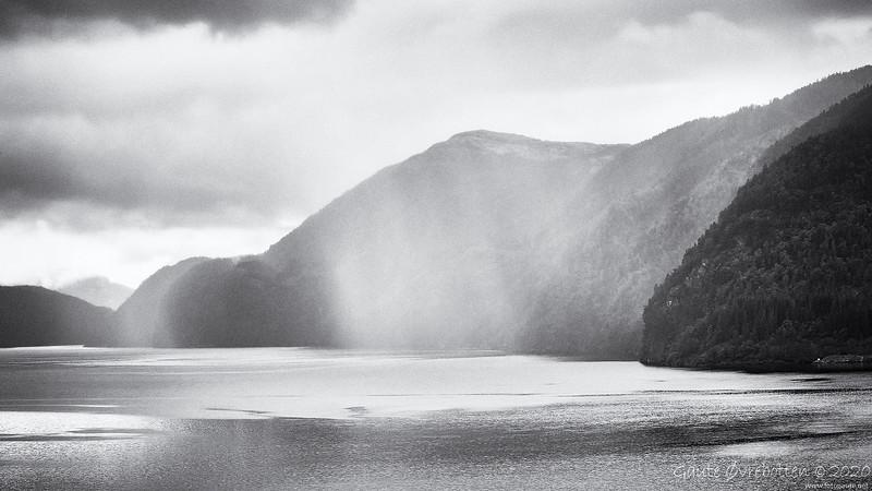 Regnbyge inn Sandsfjorden. (Shower coming.)