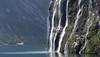 Geirangerfjorden med turistferja og Dei sju systrene. (Geiranger fiord with the cascade 'The seven sisters'.)