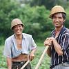 Agricultural workers break for a smile.