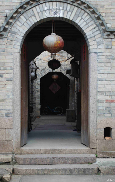 Langqi Town: Entrance to a home constructed in the traditional style.