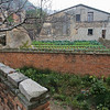 Yun Long: An older hillside home with garden.
