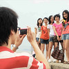 Students from the local college pose for a photograph while standing on the eastern seawall.