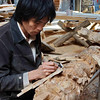 A craftsman at work in a temple under construction in Hai Yue Village.