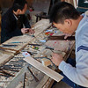 Craftsmen at work in a temple in Hai Yue Village.