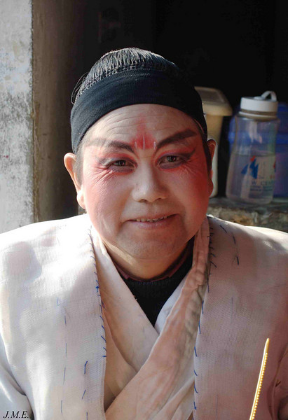 Hai Yue Community Theatre: A backstage portrait of an actor during a mid-winter afternoon performance.