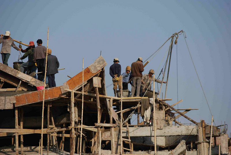 Construction crew on temple roof.