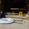 Hai Yue Village: A man constructs a circular banner to be carried in a memorial procession.
