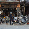 A bicycle and motorcycle repair shop in Langqi Town.