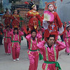 Acrobats in pink and red clothing.