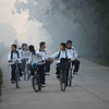 Middle school students bike home.