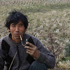 Portrait of a field worker taking a smoking break.