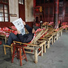 Man reading newspaper in a local community center.
