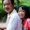 A father and daughter pause for a photograph while on their way to Langqi Town.
