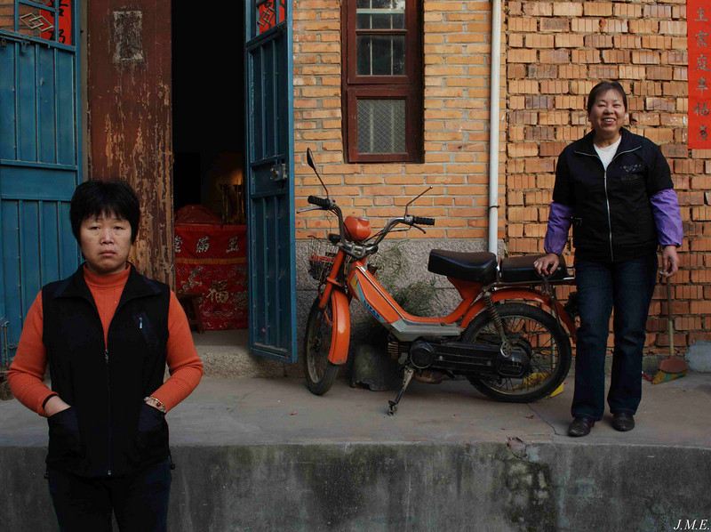 Langqi Town: Two women and a motorcycle.