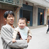 Hai Yue Village: A man holding his child for a portrait.